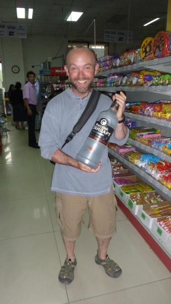 Little man with a 3 litre bottle of vodka.