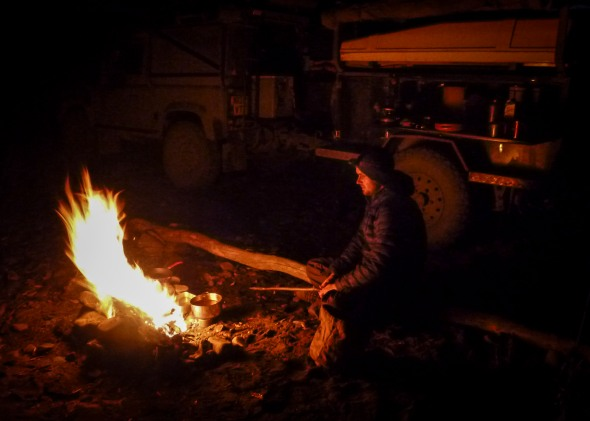 fire, road of bones, land rover, defender, 90, overland, expediton